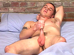 Sexy gay dude enjoys himself plying with his hard cock !
